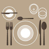 Place setting. With plate, fork, spoon and knife Stock Images