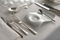 Place setting. Close-up of dressed dining table with silver cutlery Stock Photography