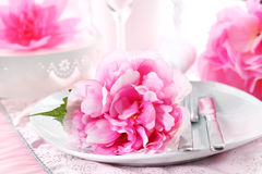 Place setting. Romantic place setting in pink stock image