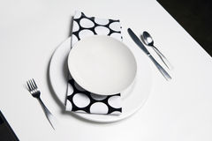 Place Setting - black and white. Looks like it belongs in a modern clean loft or trendy restaurant Royalty Free Stock Images