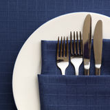 Place Setting with Blue Napkin Stock Photos