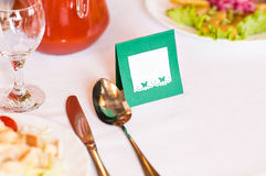 Place setting and card on a table at reception Stock Images