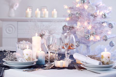 Place setting for Christmas. In white with white Christmas tree Royalty Free Stock Images