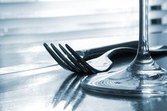 Place setting - close-up. Of knife, fork, glass - toned Royalty Free Stock Photos