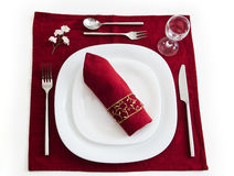 Place setting on dark red Stock Images