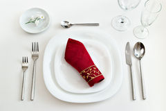 Place setting with dark red napkin Royalty Free Stock Photos