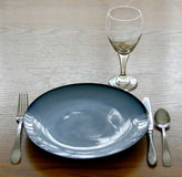Place Setting of Dishes. On table Stock Photos