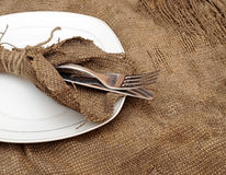 A place setting empty plate, silver fork and knife Stock Images