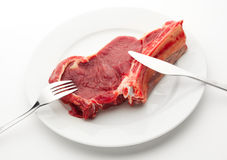 Place setting with fresh meat. On the plate Royalty Free Stock Photography