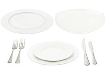 Place setting with high-gloss plate, knife & fork. Royalty Free Stock Photos