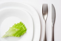Place setting with lettuce Stock Image