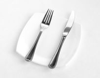 Place setting for one person: knife, square white Royalty Free Stock Image