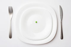Place setting with pea. Close-up shot of place setting with pea stock photo
