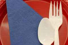 Place setting for a picnic. Plastic spoon, fork and plate for a summer picnic Stock Image