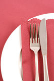 Place Setting with Pink Napkin #3. White plate, silver knife and fork, and dusky pink napkin and tablecloth royalty free stock images