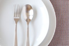 Place setting with plate and fork Royalty Free Stock Image