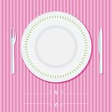 Place setting with plate, knife and fork Royalty Free Stock Images