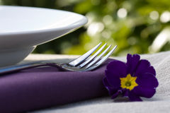 Place setting and purple flower Royalty Free Stock Image