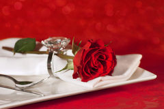 Place setting on red background Stock Photo