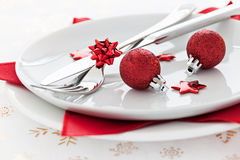 Place setting with red baubles. And star shapes Stock Images