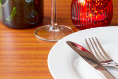 Place setting with red candle Stock Photography