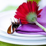 Place setting with red gerbera Royalty Free Stock Photography