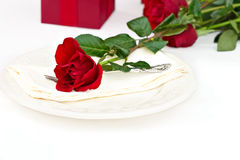 Place Setting with Red Rose Stock Photo
