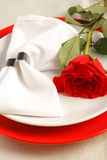 Place setting with a red rose Royalty Free Stock Photos
