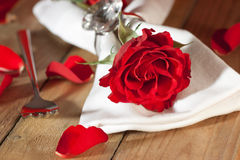 Place setting with a red rose in country style Royalty Free Stock Images