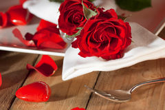Place setting with red roses in country style Royalty Free Stock Image