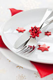 Place setting with red star shapes. And cutlery Stock Image