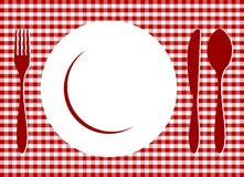 Place Setting on red tablecloth. Place Setting. Plate, spoon, fork, knife and plate on red cross-weave gingham tiles tablecloth. Food, restaurant, menu design Stock Images