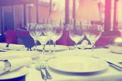 Place setting in a restaurant, toned Royalty Free Stock Image