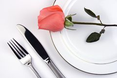 Place Setting With Rose. Place setting with pinky rose in white background royalty free stock photos