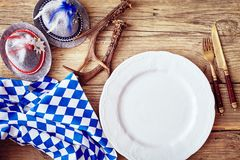 Place setting in a rustic Bavarian tavern Royalty Free Stock Images