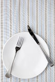 Place Setting on Striped Tablecloth. In shades of blue, white and taupe.  Overhead view Royalty Free Stock Photos