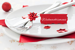 Place setting with tag and german text. Weihnachtsmenue Royalty Free Stock Photos
