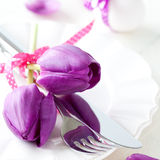 Place setting with tulips Royalty Free Stock Photos