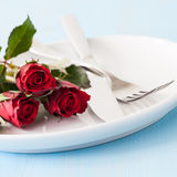 Place setting for valentines day. With red roses Royalty Free Stock Images