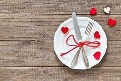 Place setting for Valentines day. On a wooden table stock photos