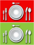 Place setting - Vector. Place setting including plates, forks, spoons and knife on a red and green Stock Photos
