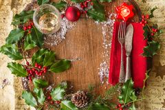 Christmas holiday place setting with vintage cutlery, glass of stock photos