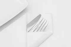 Place setting, white plate with cutlery Royalty Free Stock Images