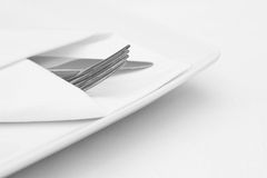 Place setting, white plate with cutlery. And white napkin Royalty Free Stock Image