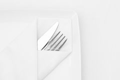 Place setting, white plate with cutlery Stock Photos