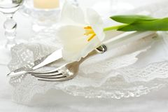 Place-setting with white tulip and napkin Stock Photography