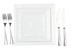 Place Setting With High-gloss Plate, Knife & Fork. Royalty Free Stock Image