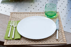 Place setting on a wood table stock image