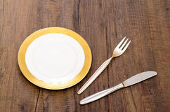 Place setting on a wooden dining table Stock Photos