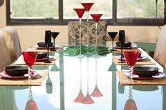 Place settings for dinner. These Champagne glasses dominate this colorful table setting Stock Photos